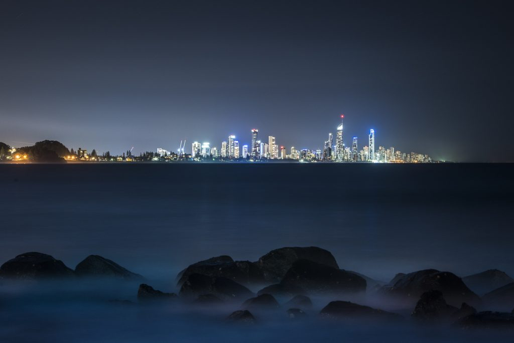 Surfers at night from Burleigh Hill